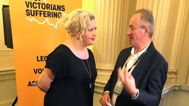Andrew Denton  speaks with Health Minister Jill Hennessy at a pro-euthanasia event last year.