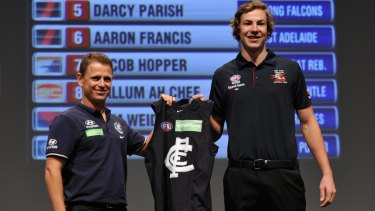High hopes: Brendon Bolton welcomes Harry McKay to the Blues with pick 10 in the 2015 draft.