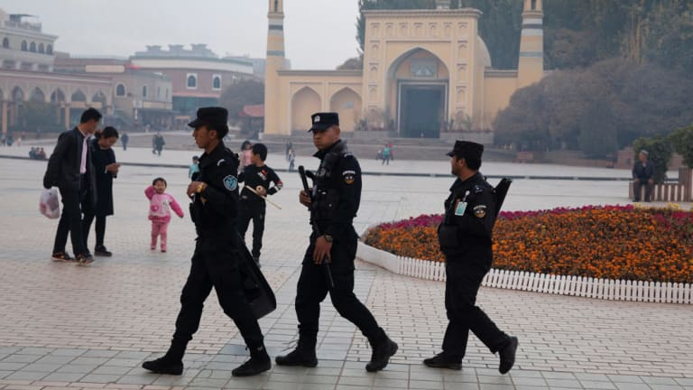 Security personnel on patrol in Xinjiang.