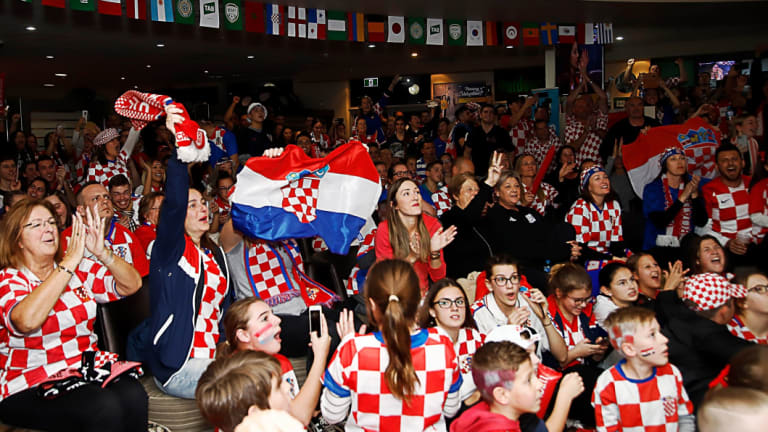 Fans celebrate at King Tom Club in Sydney after the FIFA World Cup semi-final between Croatia and England.