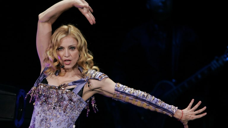 Madonna performs at the MEN arena in Manchester at the start of her European tour in 2004.