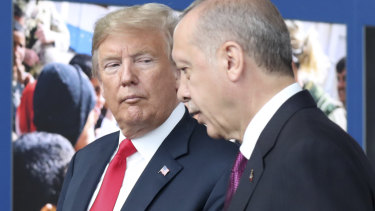 Donald Trump, left, talks to Recep Tayyip Erdogan as they tour the new NATO headquarters in Brussels in July.