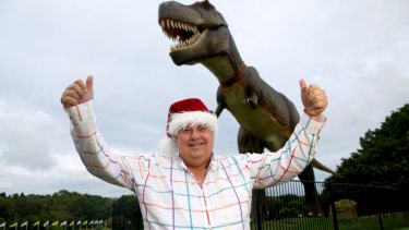 Happier days, Clive Palmer with Jeff the dinosaur at his Coolum resort. Jeff has since been destroyed by fire.