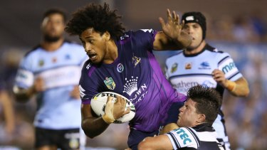 Felise Kaufusi of the Storm breaks the Sharks defence to score a try during the round four NRL match between the Cronulla Sharks and the Melbourne Storm at Southern Cross Group Stadium on March 28, 2016 in Sydney, Australia.  (Photo by Brendon Thorne/Getty Images)