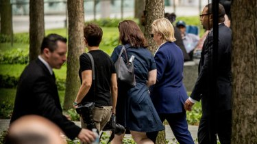 Hillary Clinton (right) leaves a 9/11 ceremony early in 2016, in an incident which was later used by her political opponents.