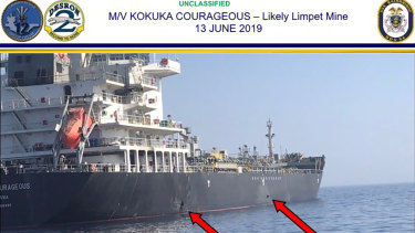 The US military's Central Command shows damage and a suspected mine on the Kokuka Courageous in the Gulf of Oman near the coast of Iran.