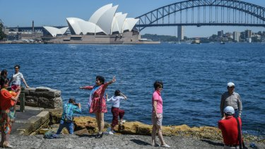Tourists take in Sydney Harbour at Lady Macquaries Chair.