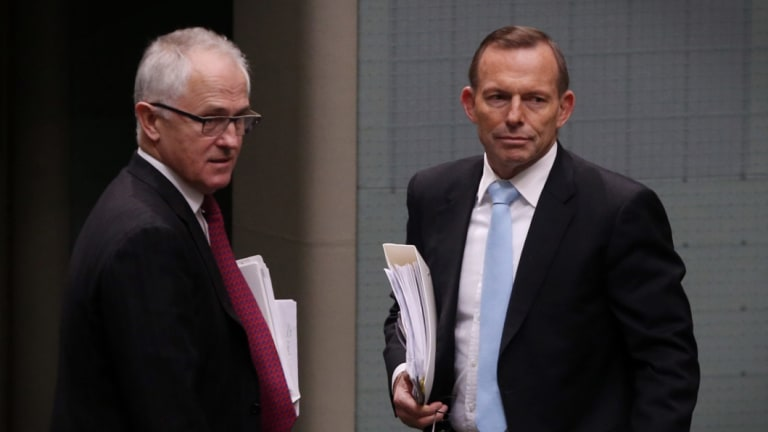 Prime Minister Malcolm Turnbull, left, highlighted his predecessor Tony Abbott's pledge.