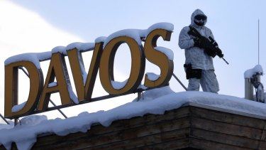 An armed member of the Swiss Police watches from the roof of the Hotel Davos ahead of the World Economic Forum (WEF) in Davos, Switzerland.