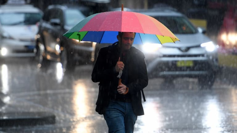 A man braves the rain on Friday afternoon.