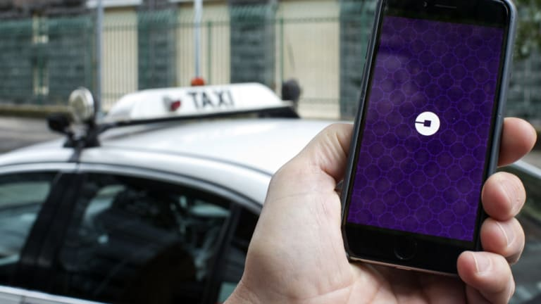 The Uber driver was arrested at a Liverpool home and charged over the alleged incident.