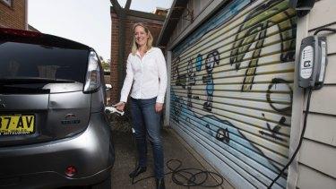 Carola Jonas chargers her electric Mitsubishi EV car.