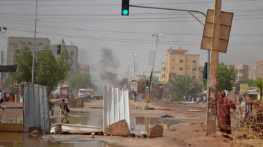 Barricades laid by protesters block a street in Khartoum to stop military vehicles from driving through amid a violent crackdown on pro-democracy protesters.