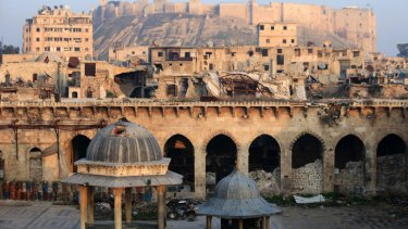 The Aleppo citadel and the heavily damaged Grand Umayyad mosque in the old city of Aleppo, Syria.