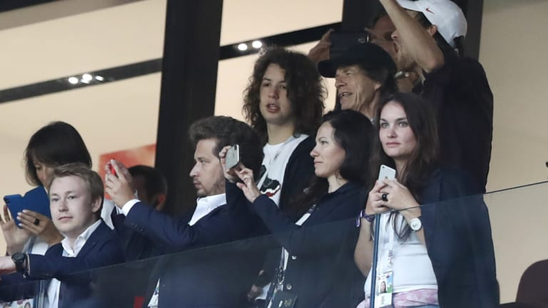 Jagger, in black baseball hat, during the semifinal match between Croatia and England.