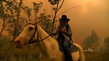 Rhonda Anderson evacuated on horseback from the Mount Larcom fire.