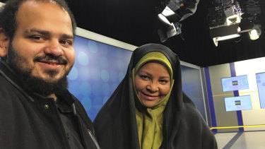American-born news anchor Marzieh Hashemi, right, smiles as she stands with her son in Tehran, Iran.