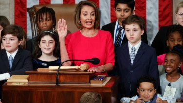 Nancy Pelosi of California, surrounded by her grandchildren,  takes the oath to become the Speaker of the House at the Capitol in Washington.