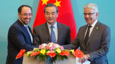From left, Afghanistan's Salahuddin Rabbani, China's Wang Yi and Pakistan's Khawaja Asif at the first China-Afghanistan-Pakistan Foreign Ministers' Dialogue in Beijing in December.