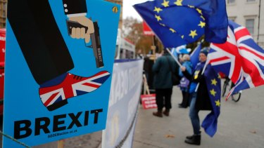 Protesters demonstrate against Brexit outside the British Parliament.