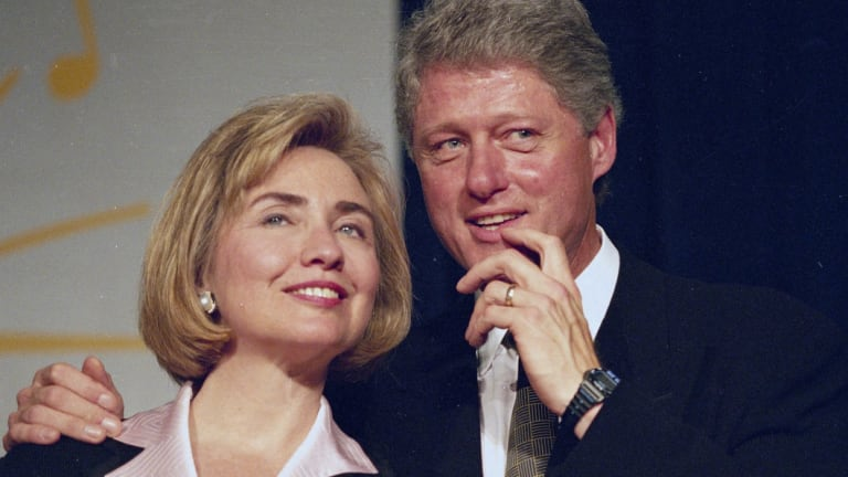 June 22, 1994: President Bill Clinton and first lady Hillary Clinton wait to address a group of young Democratic supporters known as the Saxophone Club in Washington.