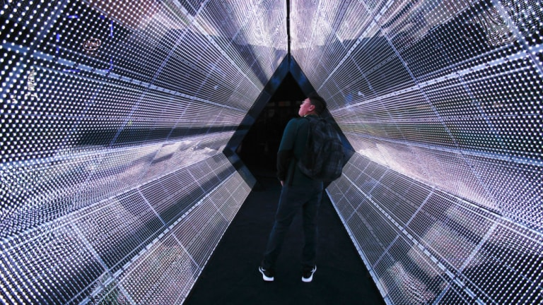A man stands in the 5G tunnel at the Intel booth at CES International in Las Vegas