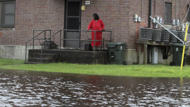 Residents at Trent Court Apartments wait out the weather as rising water gets closer to their doors in New Bern, North Carolina.