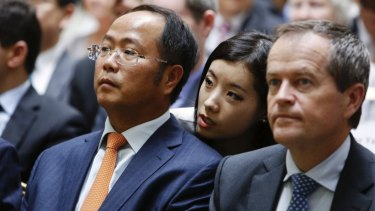 Yuhu Group chairman Huang Xiangmo (left), pictured in 2013, is a billionaire businessman.