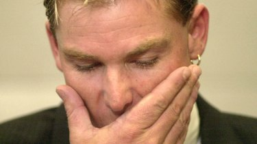 Mum's the word: Shane Warne faces the media after being suspended from cricket for 12 months in 2003. Cricket Australia want to apply the lessons of Warne's post-ban reintegration to the returns of Steve Smith and Dave Warner.