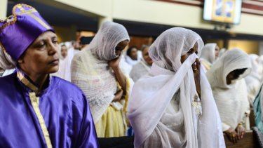 Members of the Ethiopian community take part in a special prayer for victims of the crash at the Ethiopian Orthodox Tewahedo Church of Canada Saint Mary Cathedral in Toronto on Sunday.