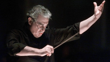 Placido Domingo directs the Washington Opera Orchestra and Chorus during a rehearsal of Verdi's Requiem in 2001.