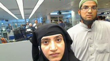 San Bernardino shooters Tashfeen Malik, left, and Syed Farook pictured passing through O'Hare Airport in Chicago in July 2014.
