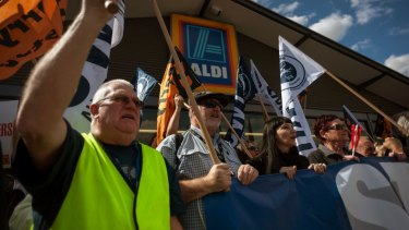 TWU members protest outside an Aldi supermarket, demanding 'safe rates' for truck drivers.