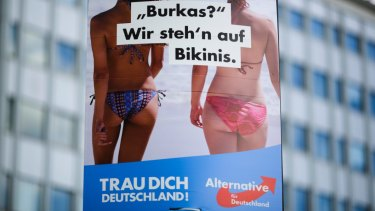 "An election campaign poster of the German nationalist anti-migrant party AfD, Alternative for Germany, reading ""Burkas? We like bikinis."""