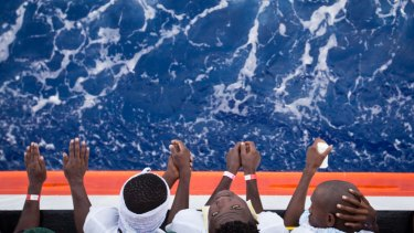 African migrants stand on the deck of the Aquarius.