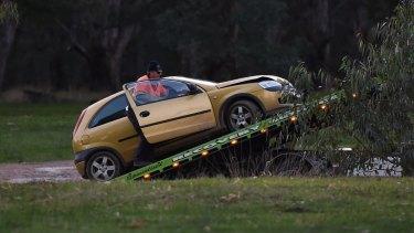The alleged extremists' car is towed from the scene in Barnawartha North.