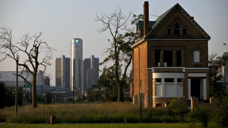 A vacant, boarded up house on the outskirts of Detroit tells the story of the city's past.
