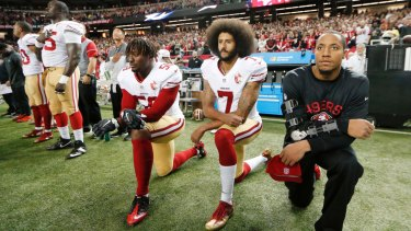 Taking a knee to make a stand: San Francisco 49ers quarterback Colin Kaepernick (7) and Eli Harold (58) kneel during the playing of the national anthem before an NFL game in 2016.