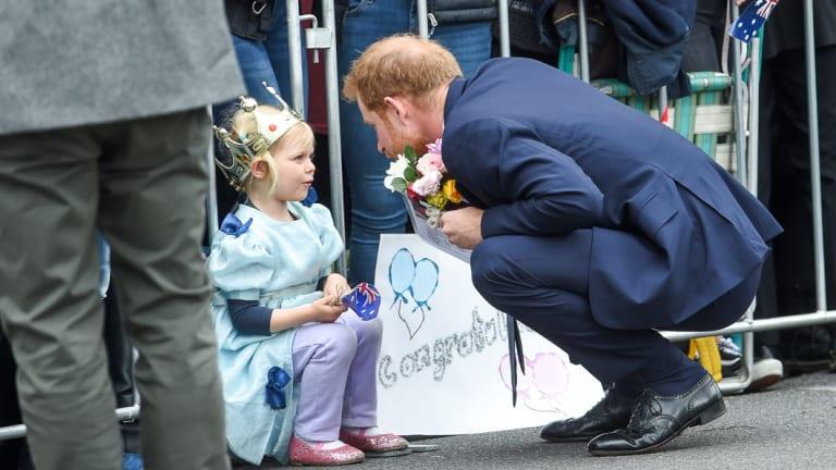 Prince Harry meets a little princess.