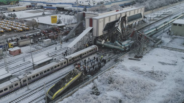 The train ran into a pedestrian overpass, killing several people.