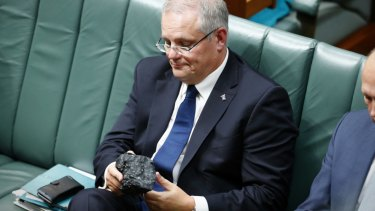 Treasurer Scott Morrison brings a lump of coal into Parliament in 2017.