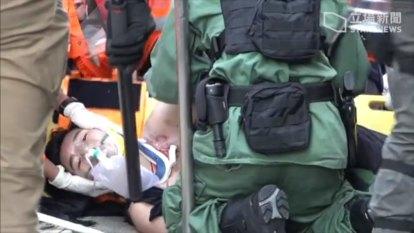 Protester shot, acid attack reported in escalating Hong Kong violence