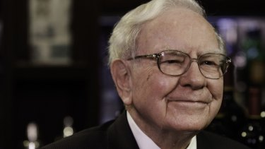 Buffett sees his own firm's shares as a good investment at a time when he's expressed concern about several other industries.