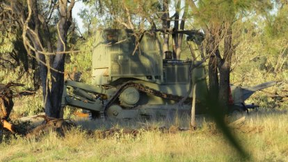 'Disgusted': NSW government drops land-clearing action against farmers