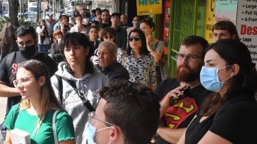 Hundreds queue outside a Centrelink office as jobs evaporate.