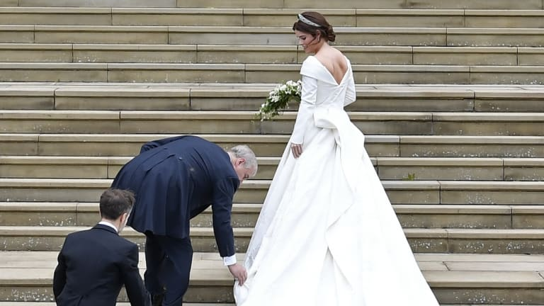 Britain's Princess Eugenie, accompanied by her father Prince Andrew, arrives for her wedding ceremony to Jack Brooksbank in St George's Chapel, Windsor Castle on Friday.