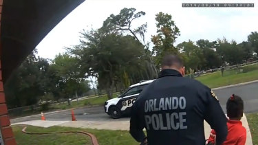 Orlando Police Officer Dennis Turner leads 6-year-old Kaia Rolle away after her arrest for kicking and punching staff members at the Lucious & Emma Nixon Academy Charter School in Orlando, Florida.