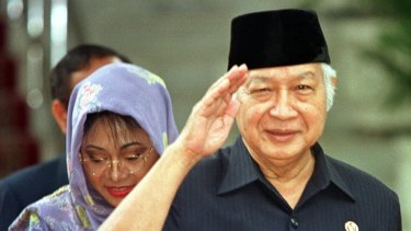 Former Indonesian President Suharto, right, salutes after announcing his resignation in 1998.