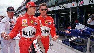 Ferrari drivers Michael Schumacher and Eddie Irvine at the Melbourne Grand Prix in 1998.