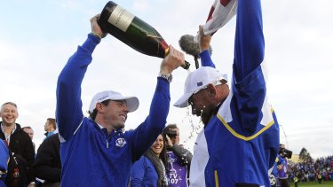 Teammates: Rory McIlroy (left) and Paul McGinley celebrate winning the 2014 Ryder Cup.